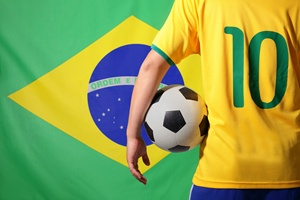 a man holding a soccer with flag