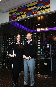 Corrie Watson and her twin brother, Will Churchill, added amenities to draw customers to their three Fort Worth auto dealerships. Inside their Cadillac store, a small shop sells wine for up to $4,500 a bottle. Credit: Brandon Wade for The New York Times